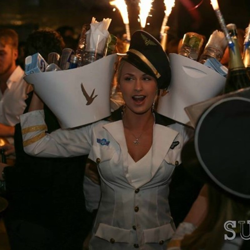 Table hostess Amanda bringing out the bottles at Suite dressed in a sailors costume