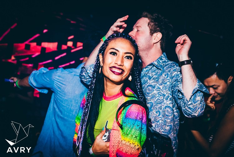 Avry nightclub Singapore pretty tanned girl with braided hair and unicorn clothes