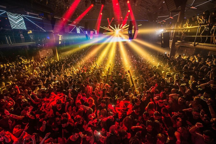 amnesia nightclub ibiza amazing concert music show full crowd dancing and having fun atmosphere colored lights