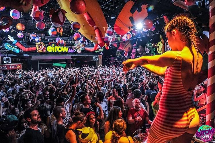 Amnesia nightclub Ibiza sexy dancer dancing for crowd balloons circus themed event