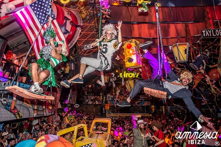 Amnesia nightclub Ibiza acrobats on swinging chairs dressed in costumes