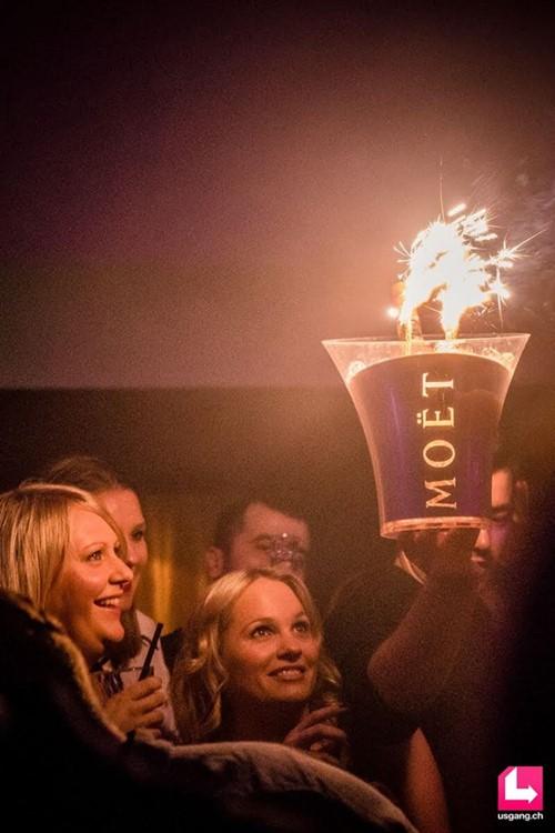 Aura Club nightclub Zurich blonde girls with big alcohol bottles vodka champagne