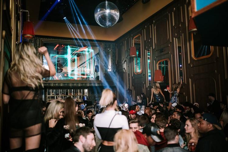 Avenue nightclub New York full crowd sexy girls dancing in mini skirts