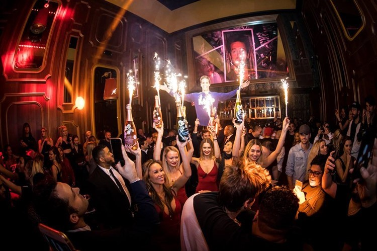 Avenue nightclub New York waitresses holding champagne bottles party show