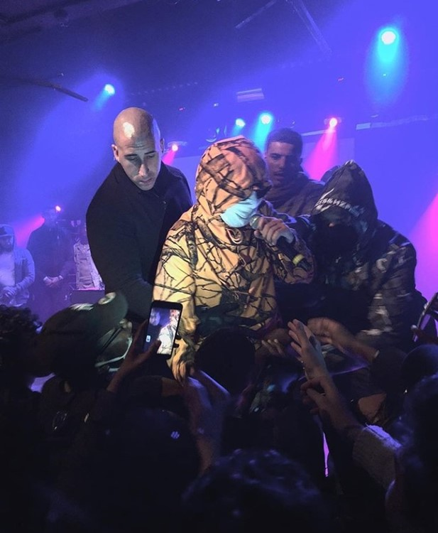 Badaboum nightclub Paris singer wearing mask singing to crowd