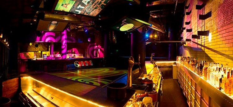 bikini nightclub barcelona view of the club with colored lights and empty dance floor and alcohol bar view