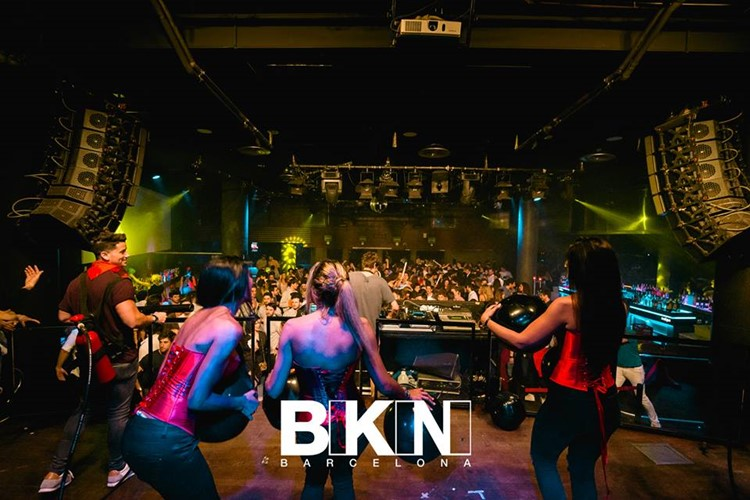 bikini nightclub barcelona exotic dancers throwing a dance show at a band musicians concert and dj playing with full crowd of prtying people