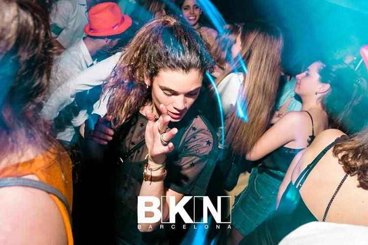 bikini nightclub barcelona full night party pretty brunette dancing in the crowd with blue lights