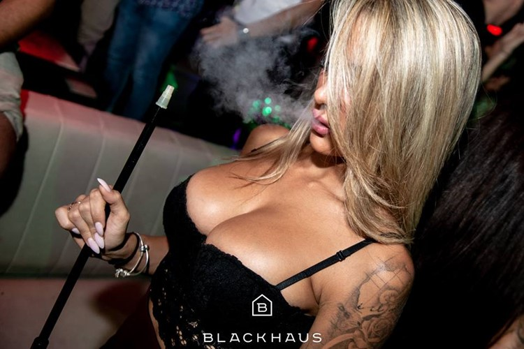 Blackhaus Club nightclub Madrid sexy blonde girl smoking partying