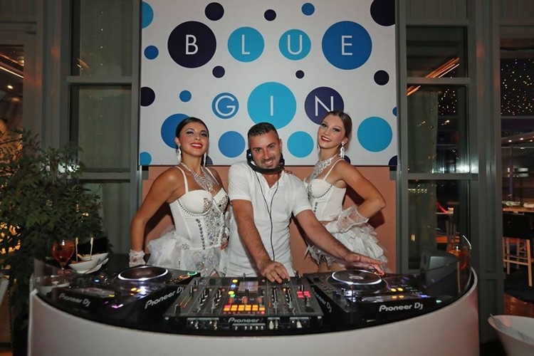 Blue Gin nightclub Monaco dj mixing music with two brunette sexy girls all dressed in white