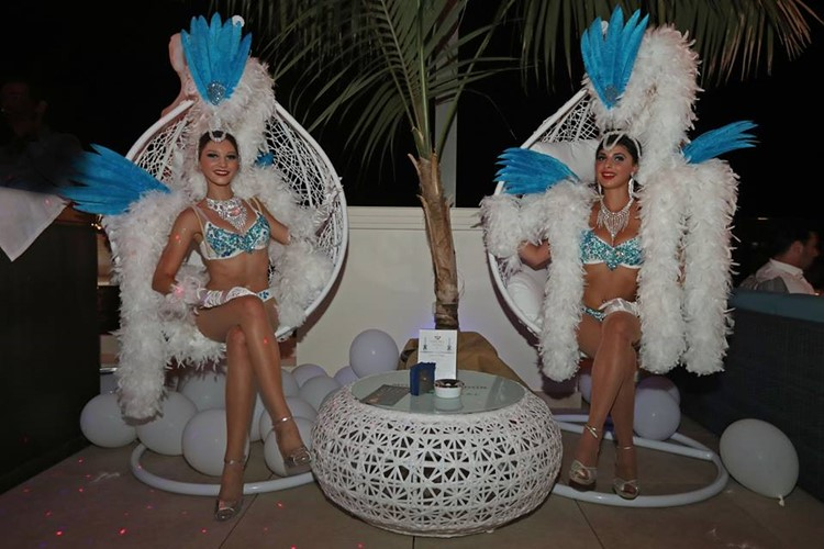 Blue Gin nightclub Monaco two exotic dancers dressed in sexy white and blue lingerie