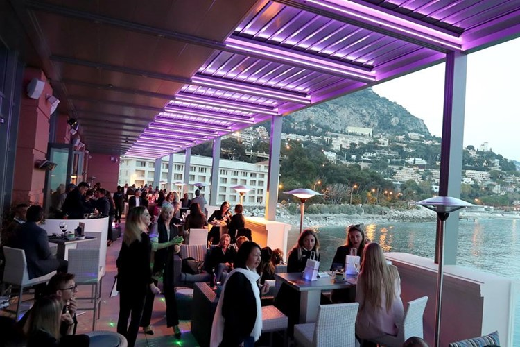 Blue Gin nightclub Monaco view of the club people having drinks at the lounge area