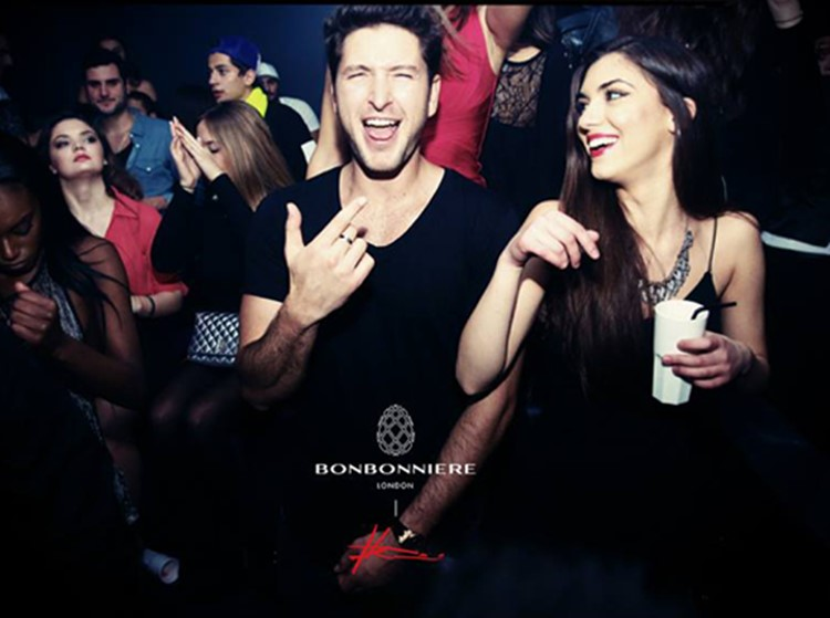 bonbonniere nightclub london brunette girl and boy drinking and having fun