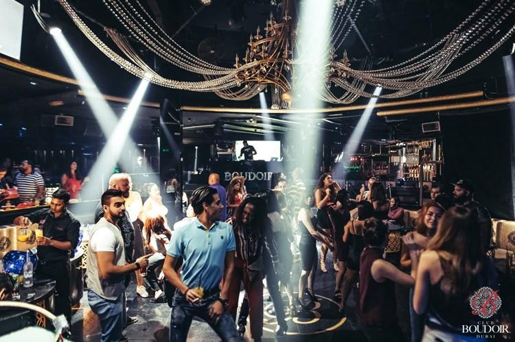 Boudoir Club nightclub Dubai people having fun party drinks