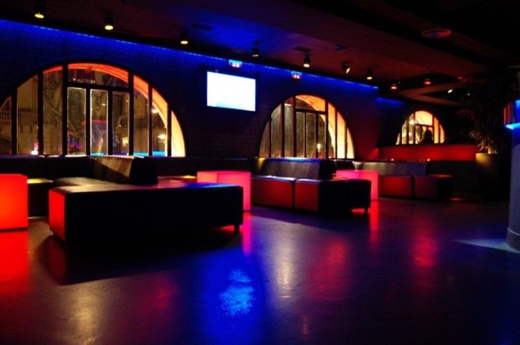 Boulevard nightclub Barcelona view of the interior inside the club modern furniture colored blue and red lights