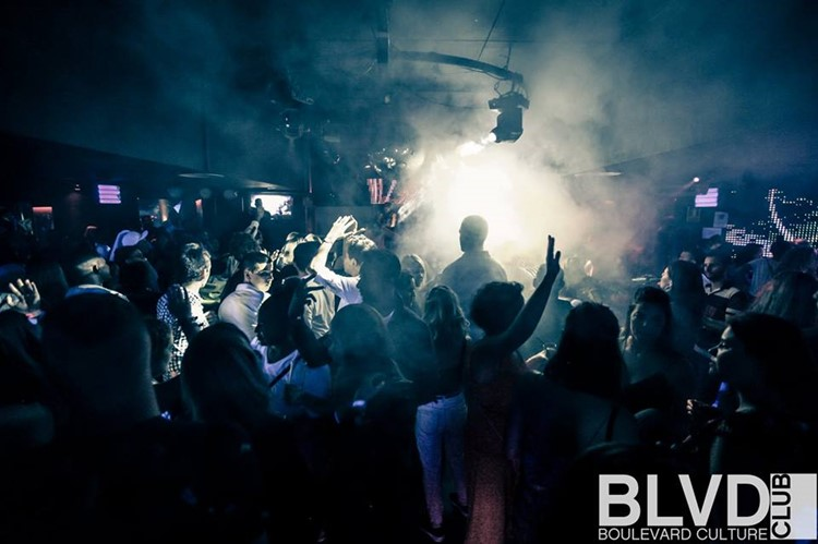 Boulevard nightclub Barcelona full night party crowd of people having fun and dancing smoke special effects