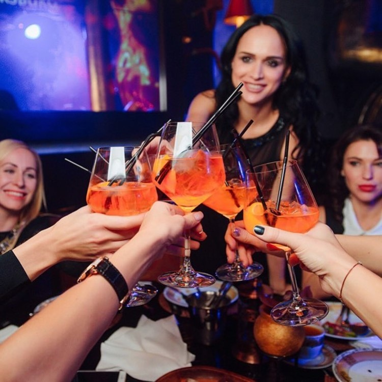 Buddha Bar nightclub Saint Petersburg girls having fun drinks alcohol table service cocktails