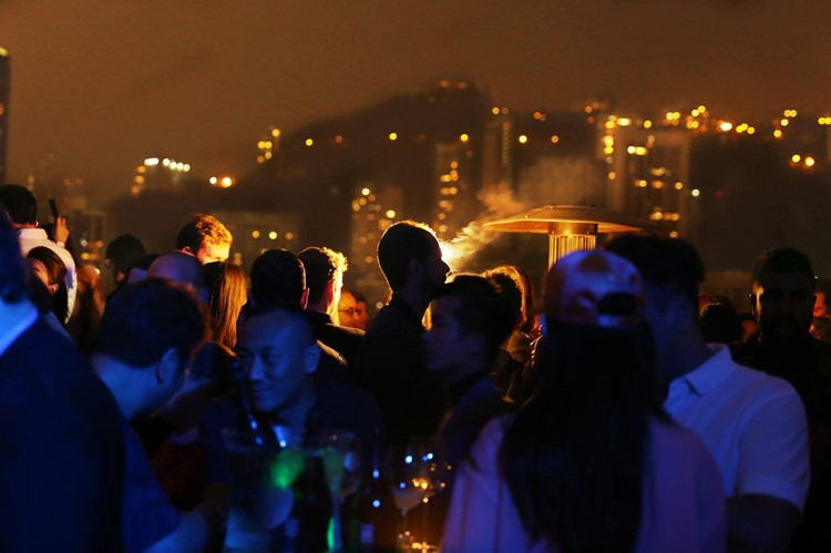 Ce La Vi nightclub Hong Kong crowd at event outside view of the city