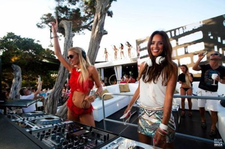Café Mambo club Ibiza two blonde and brunette girls djs mixing music in sexy dresses
