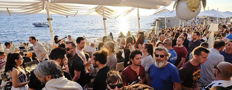 Café Mambo club Ibiza crowd having fun at event sunny beach