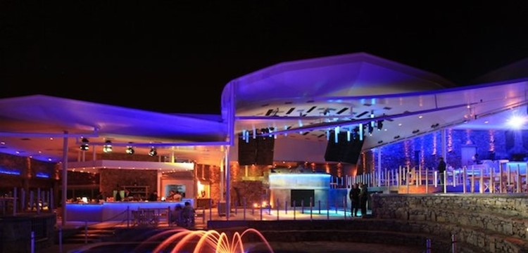 Cavo Paradiso nightclub Mykonos view of the empty club at night colored lights lighting up the place