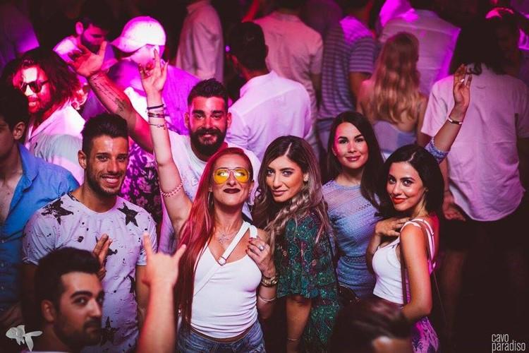 Cavo Paradiso nightclub Mykonos crowd of people dancing and having fun four pretty girls posing