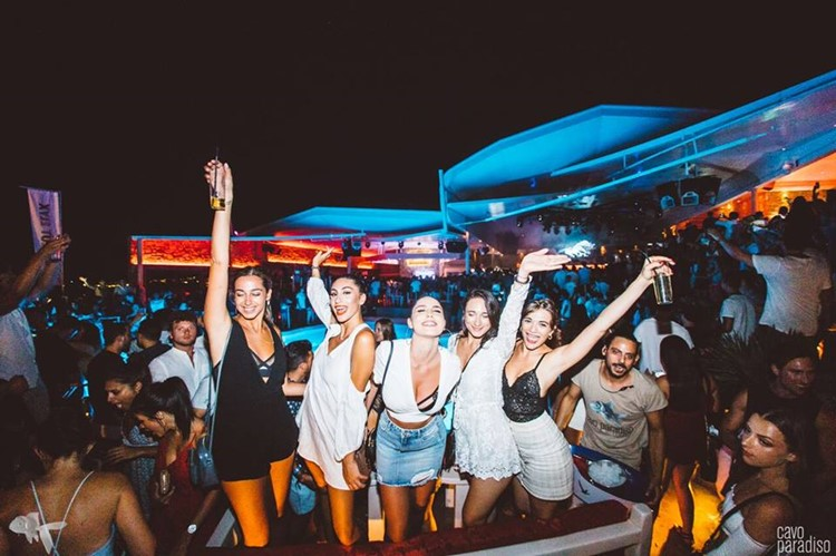 Cavo Paradiso nightclub Mykonos full night party five pretty girls dancing and having fun dressed in mini skirts drinking alcohol