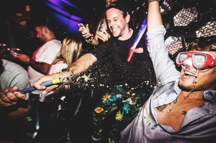 Chin Chin nightclub Amsterdam men having fun throwing alcohol