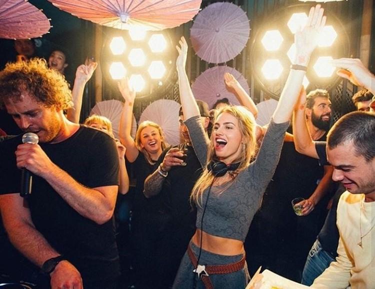 Chin Chin nightclub Amsterdam blonde girl dressed in grey skirt headphones dj mixing music