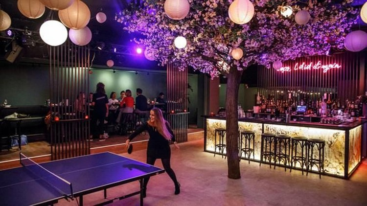 Chin Chin nightclub Amsterdam girl playing ping pong