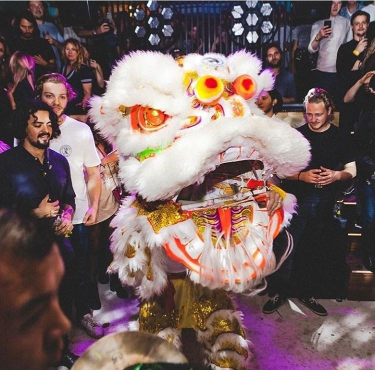 Chin Chin nightclub Amsterdam boys next to dragon head decoration traditional