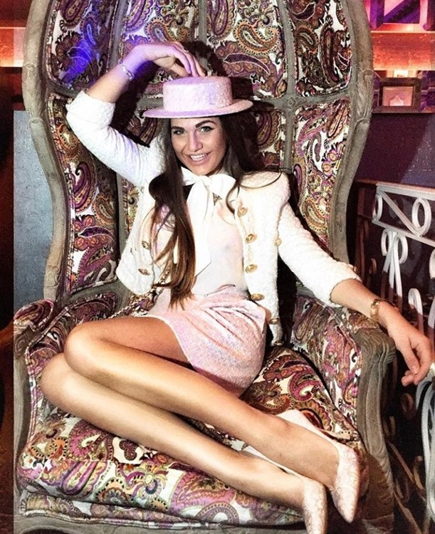 Chrystie nightclub Cannes beautiful brunette girl dressed in pale pink dress and high heels on big chair