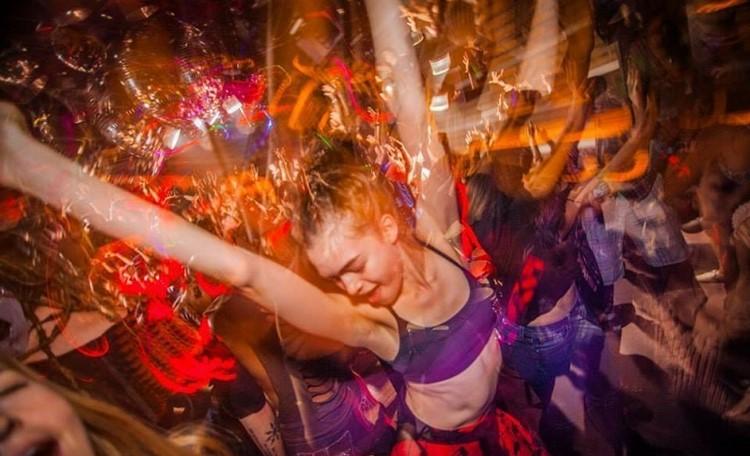 Cielo nightclub New York girl dancing having fun crowd partying
