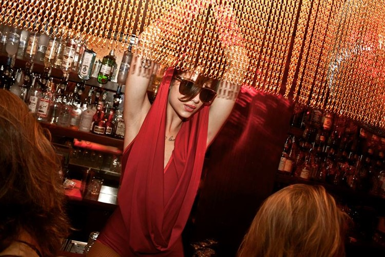 Club NL nightclub Amsterdam exotic dancer dancing on bar golden chains red lights