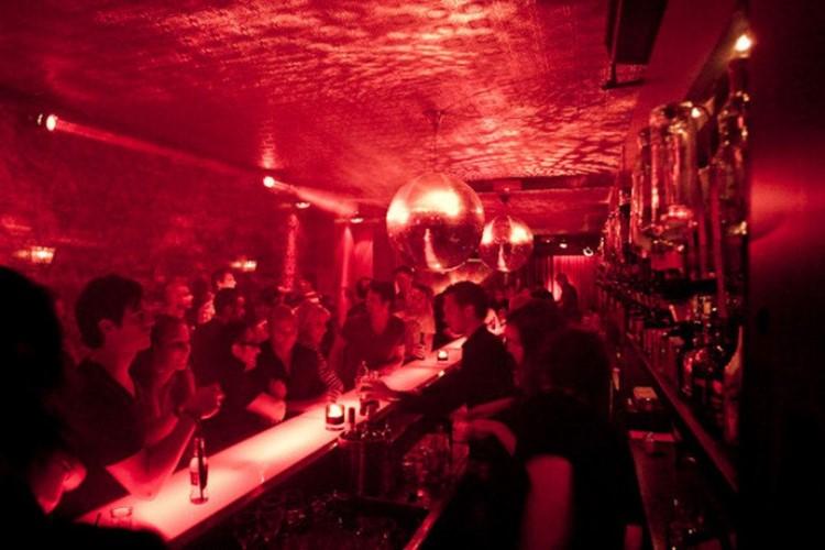 Club NL nightclub Amsterdam view of the bar people having drinks red lights