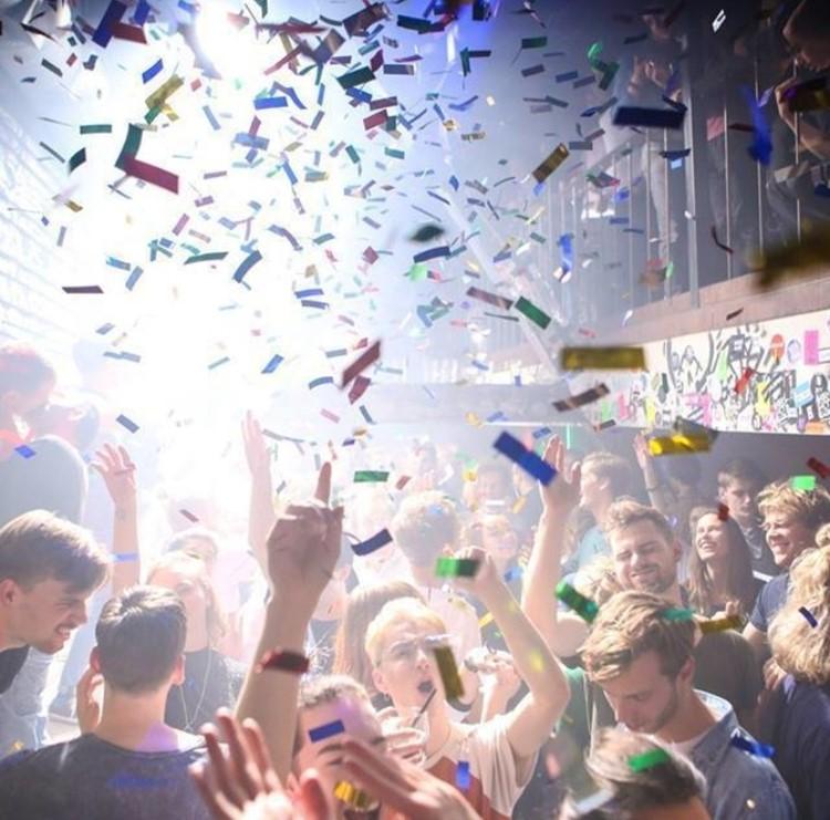Club Nyx nightclub Amsterdam crowd dancing confetti in the air