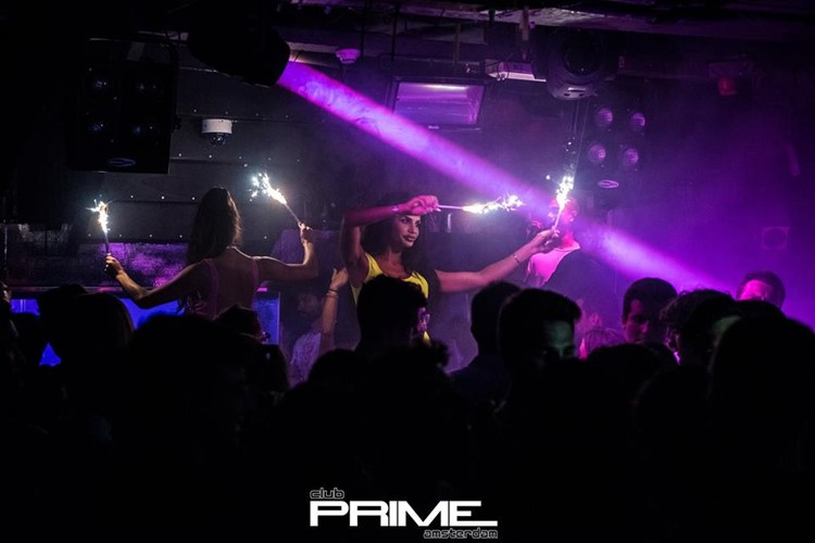 Club Prime nightclub Amsterdam exotic dancers holding sparkling lights
