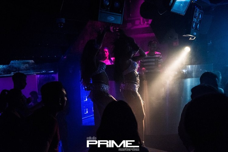 Club Prime nightclub Amsterdam sexy exotic dancers pole dancing wearing white lingerie