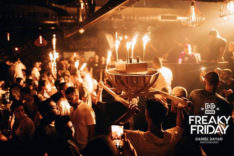 Coco nightclub Tel Aviv crowd having fun drinking partying