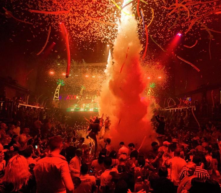 Coco Bongo nightclub Cancun people dancing fun party show drinks alcohol bottles