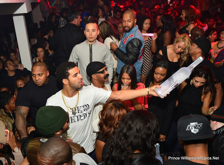 Compound Club nightclub Atlanta famous celebrity singer Drake alcohol bottle