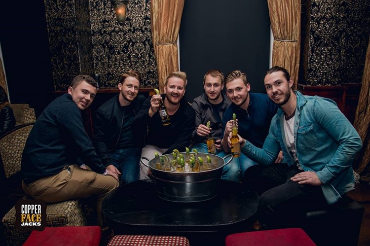 Copper Face Jacks nightclub Dublin table reservation service men guys drinking alcohol bottles