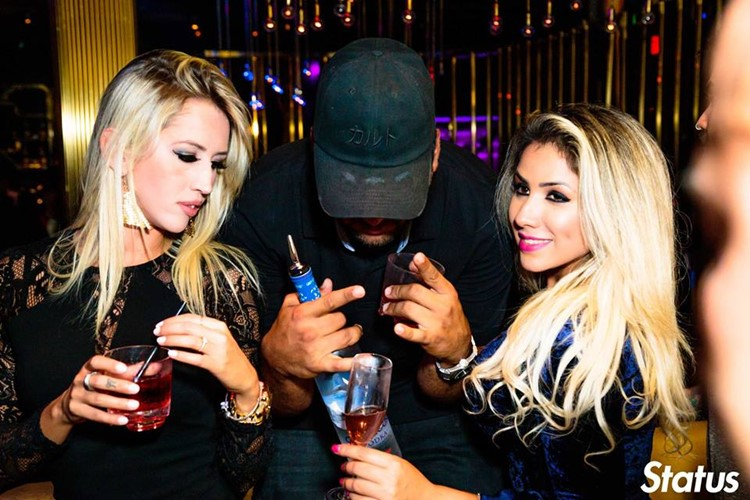 Cube nightclub Toronto sexy blonde girls drinking alcohol with man