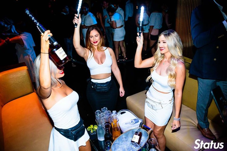 Cube nightclub Toronto blonde girls holding champagne bottles table service