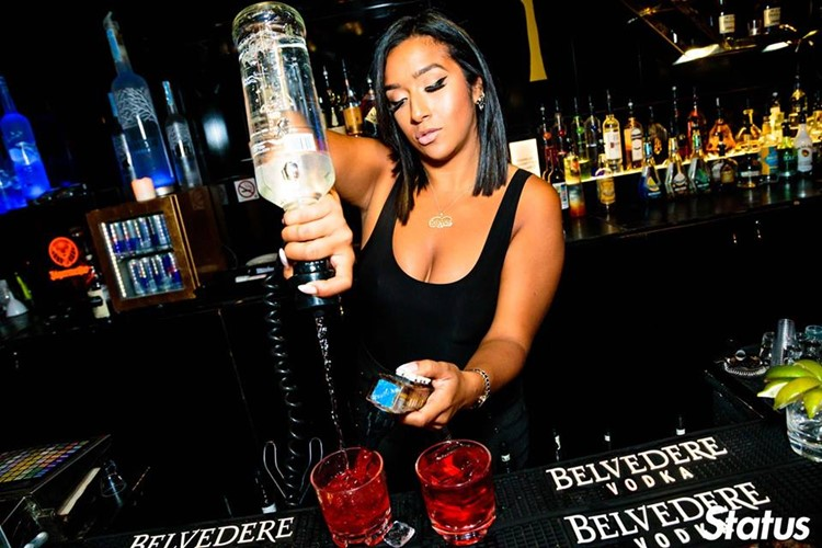 Cube nightclub Toronto sexy bartender pouring drinks vodka alcohol