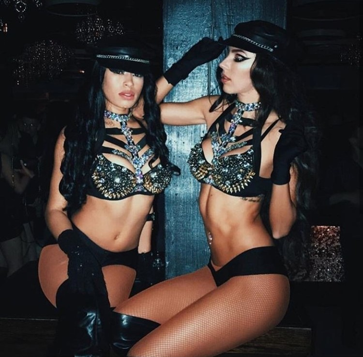 Cuvee nightclub Chicago two sexy brunette exotic dancers dressed in black lingerie