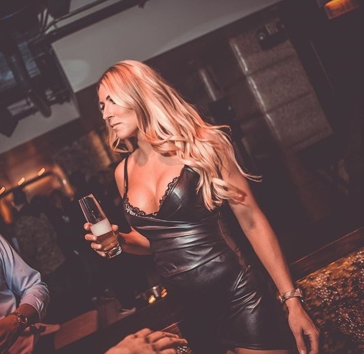 Cuvee nightclub Chicago sexy blonde girl big boobs dressed in mini black leather dress