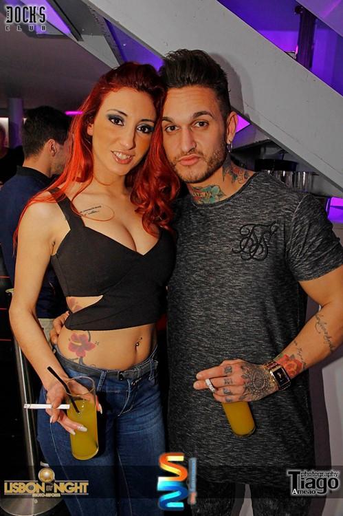Docks Club nightclub Lisbon redhead girl with boy having fun drinking alcohol