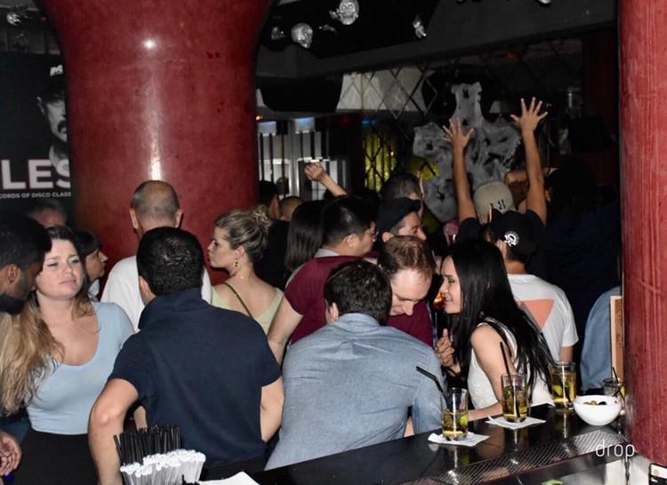 Drop nightclub Hong Kong people sitting at bar having drinks