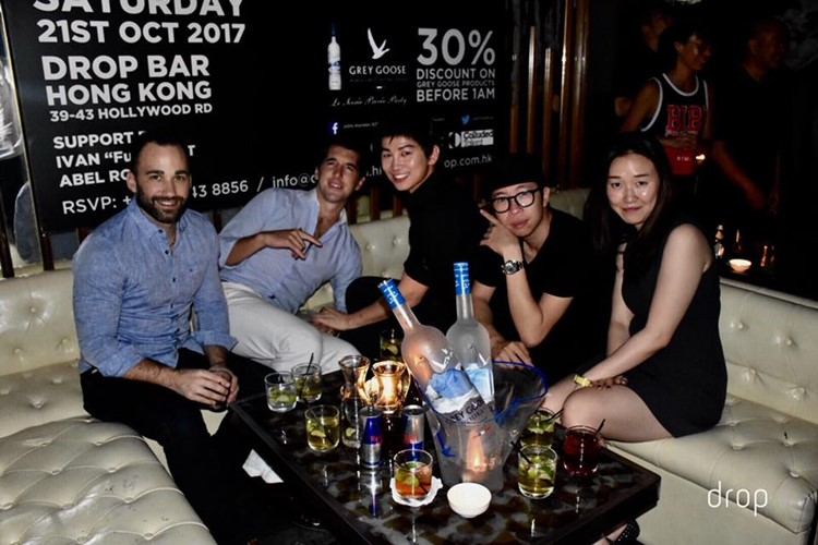 Drop nightclub Hong Kong group of girls and boys table booking bottles of alcohol vodka